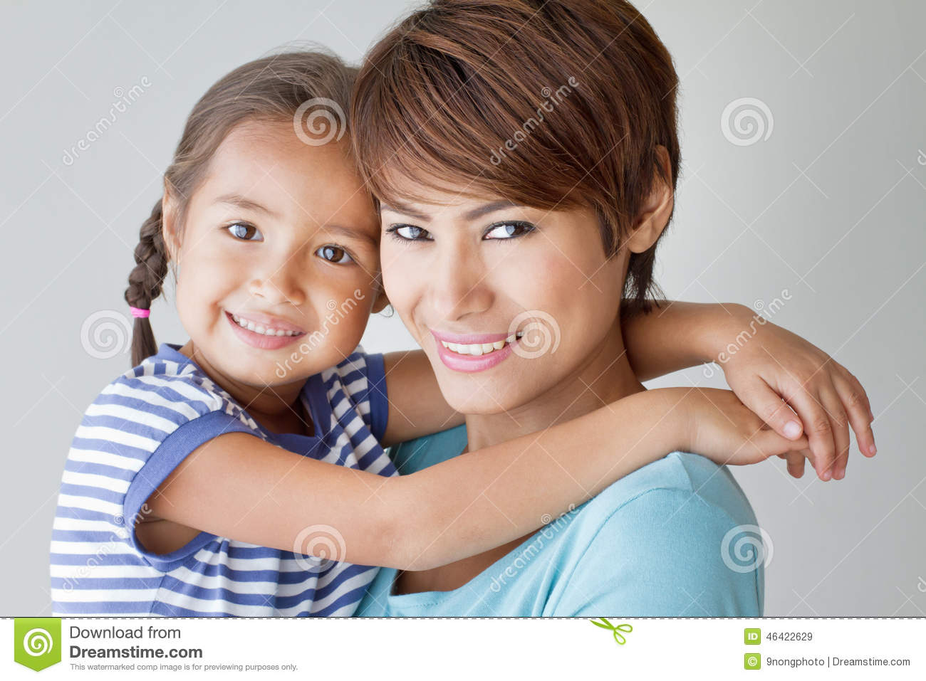 Happy family with smiling, positive daughter and mother