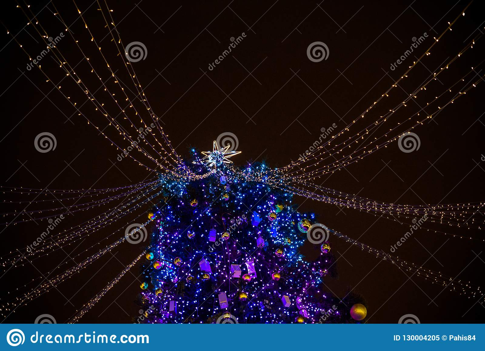 Christmas In Austria Holidays.Happy Family Spend Time At A Christmas Street Market Fair In