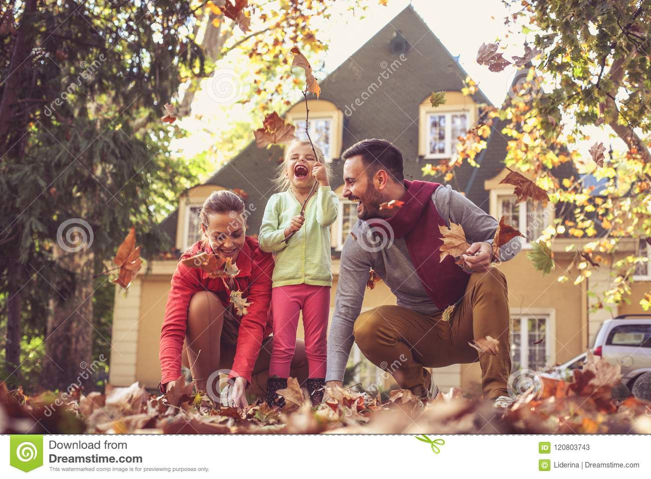 Happy family spending time together. Autumn season.