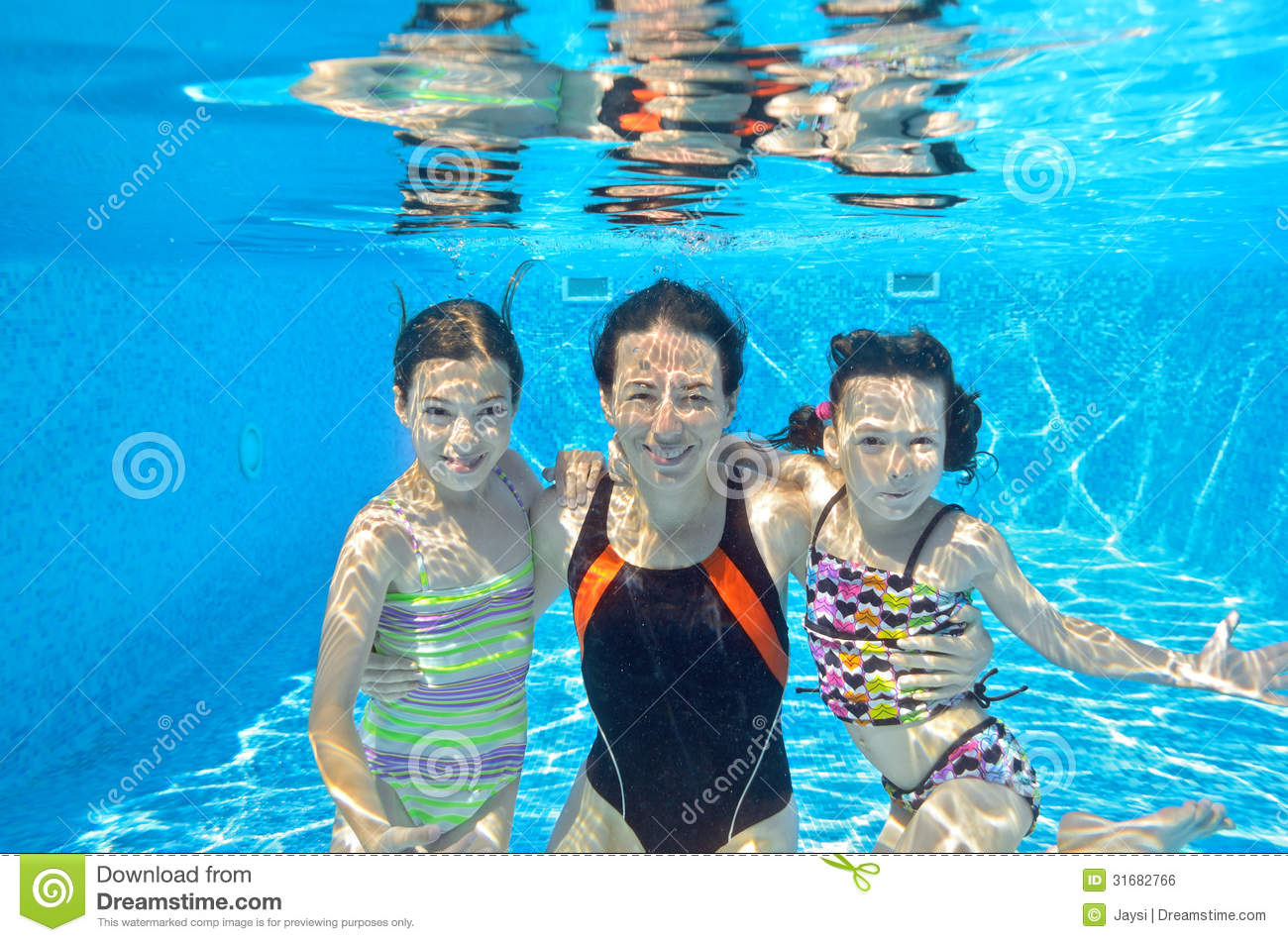 Happy family swim underwater in pool stock photo image for Family swimming pool