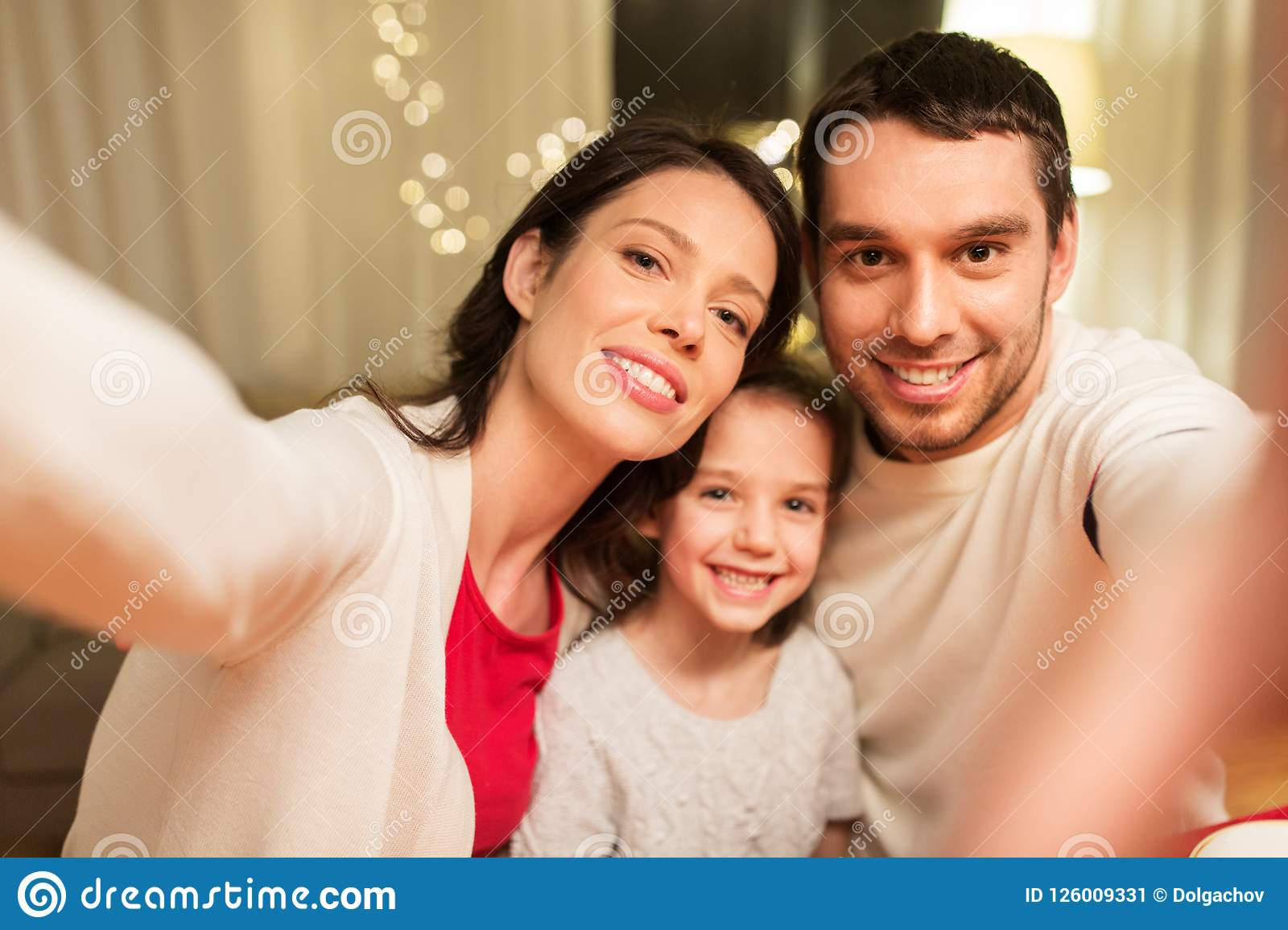 Happy family taking selfie at christmas