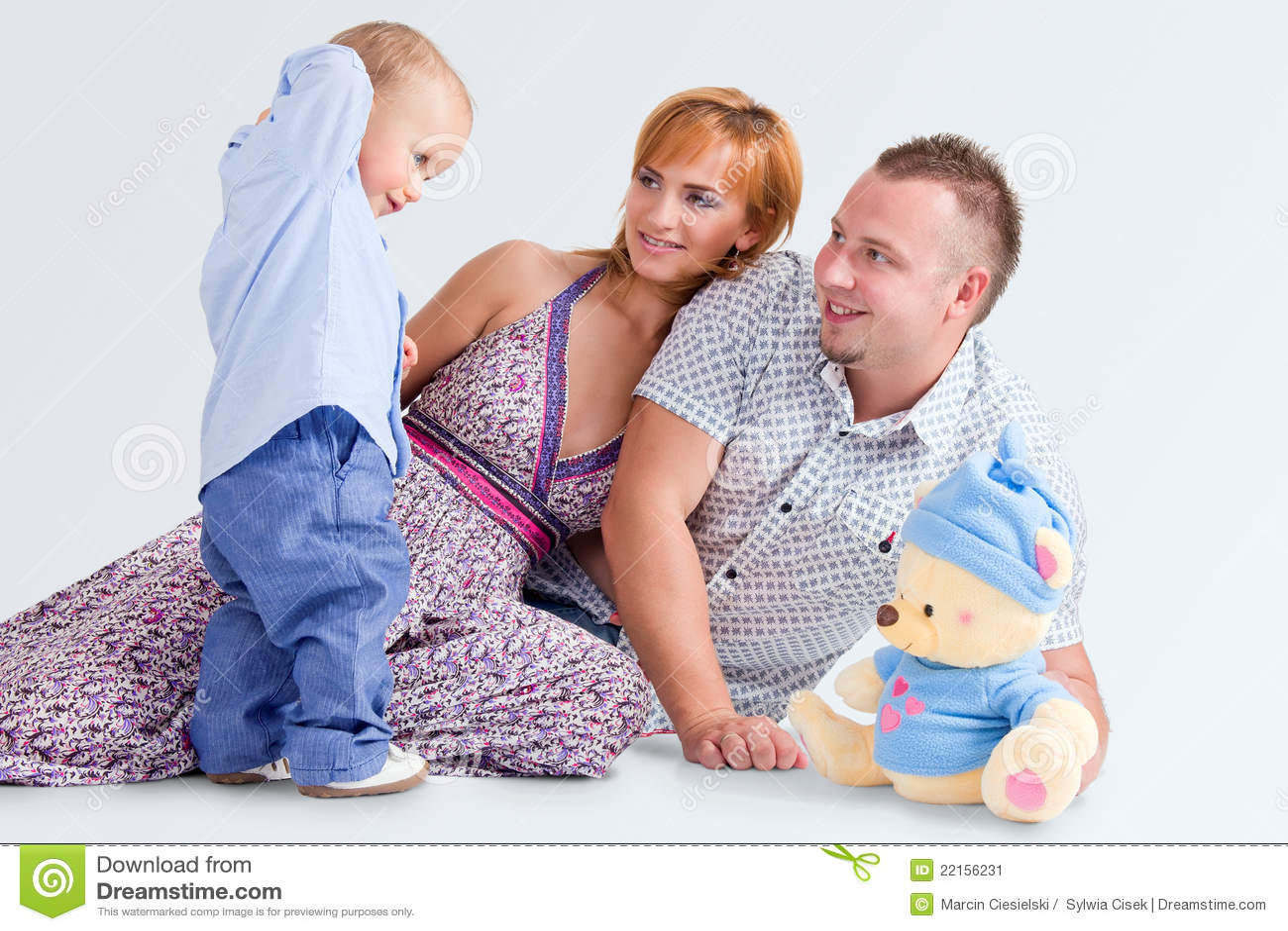 Happy family and a teddy-bear
