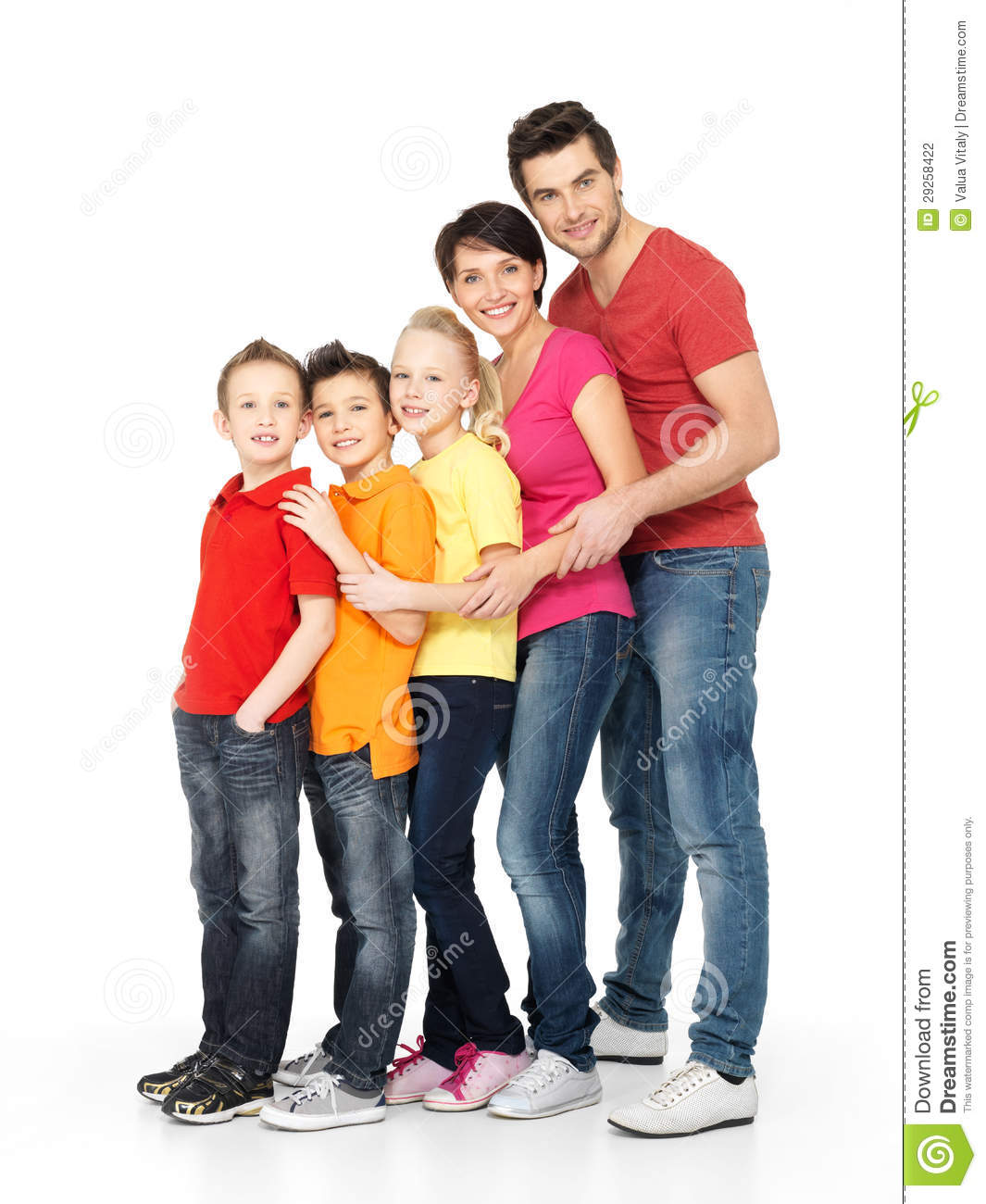 Happy Family With Three Children Standing Together Stock
