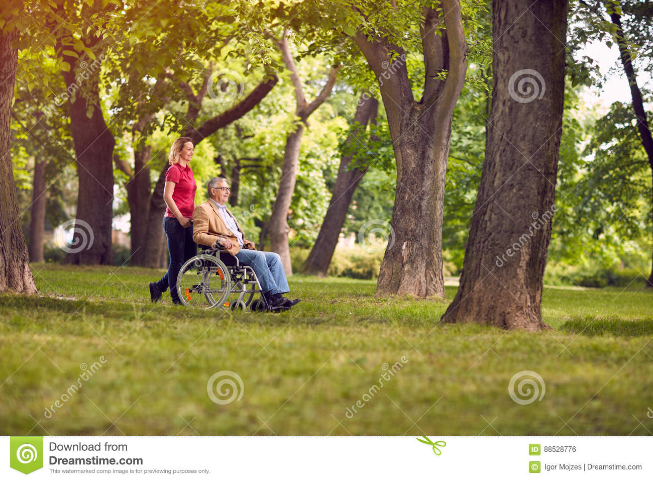 Happy family time- senior man in wheelchair and daughter in the