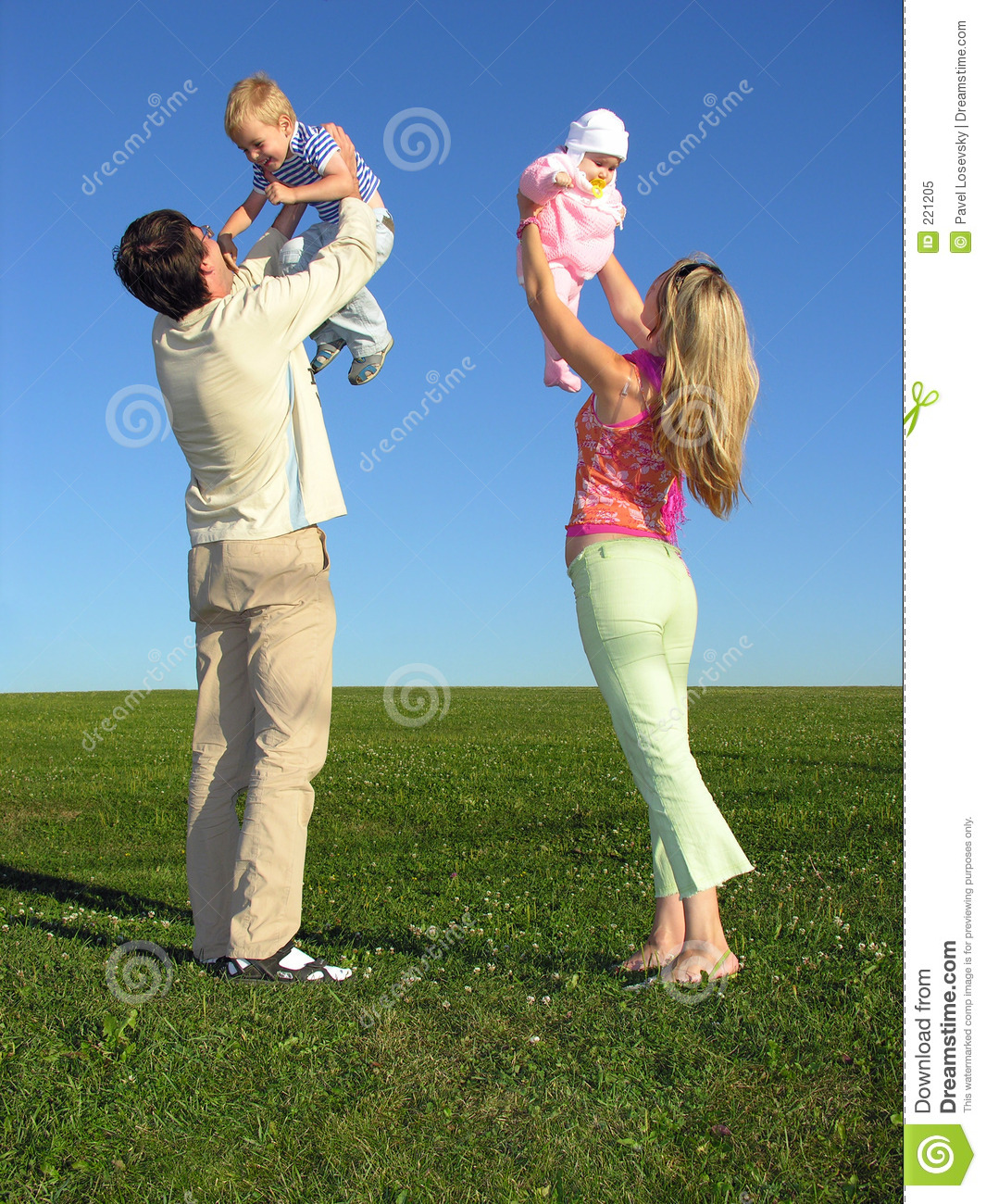 Happy family with two children on blue sky