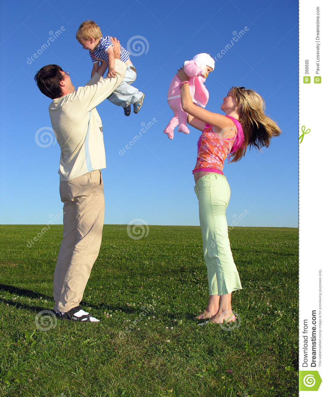 Happy family with two children on blue sky 3