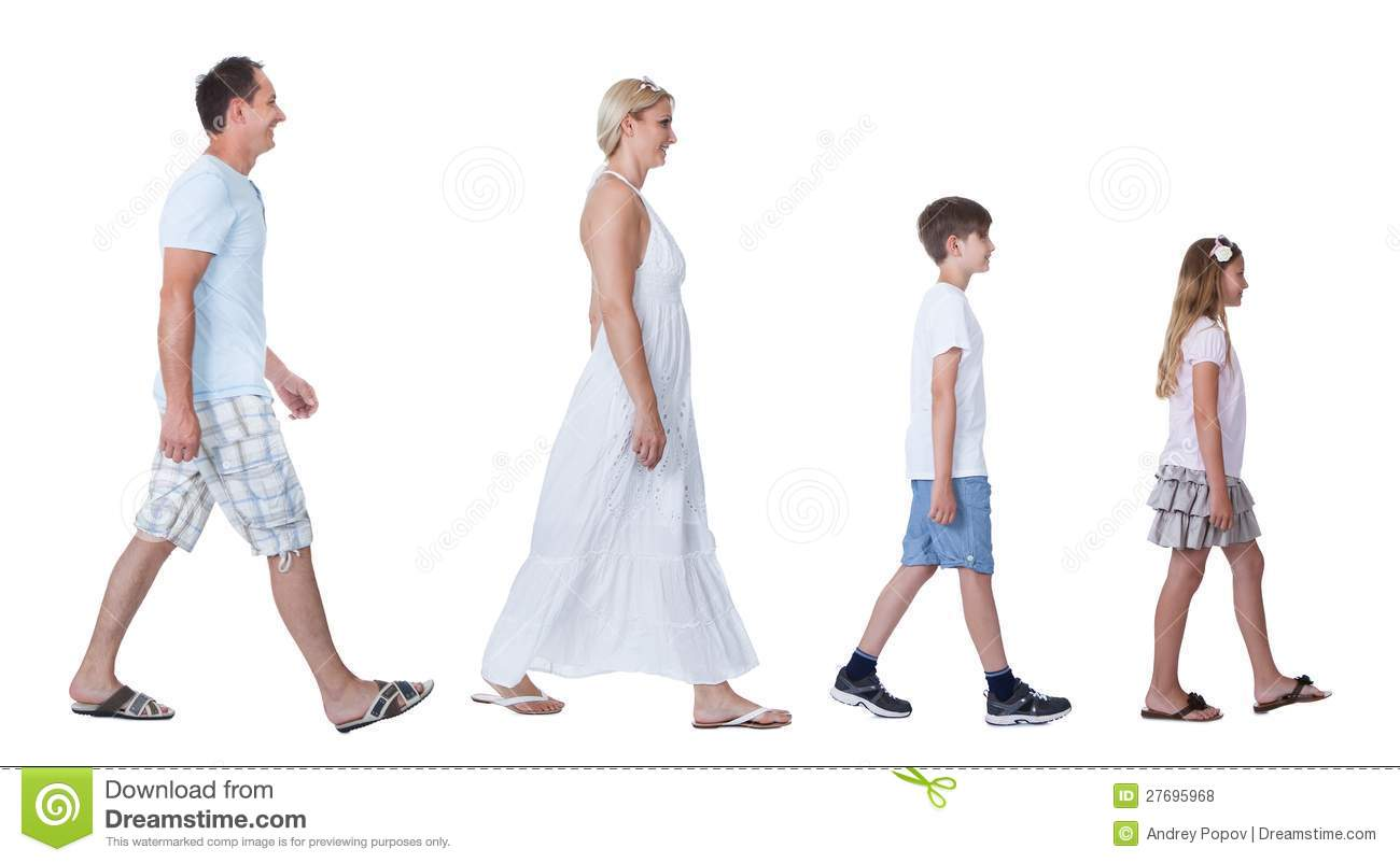 A Happy Family With Two Children Walking In A Line Royalty