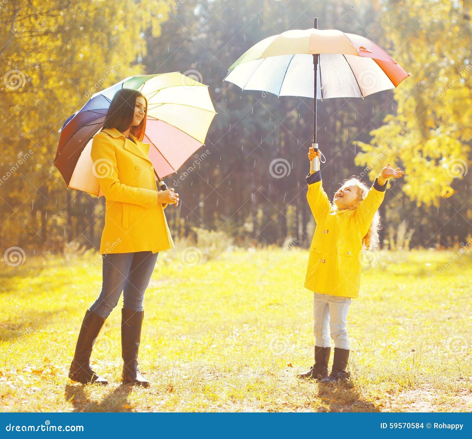 Happy Rainy Day: Happy Family With Umbrellas In Sunny Autumn Rainy Day