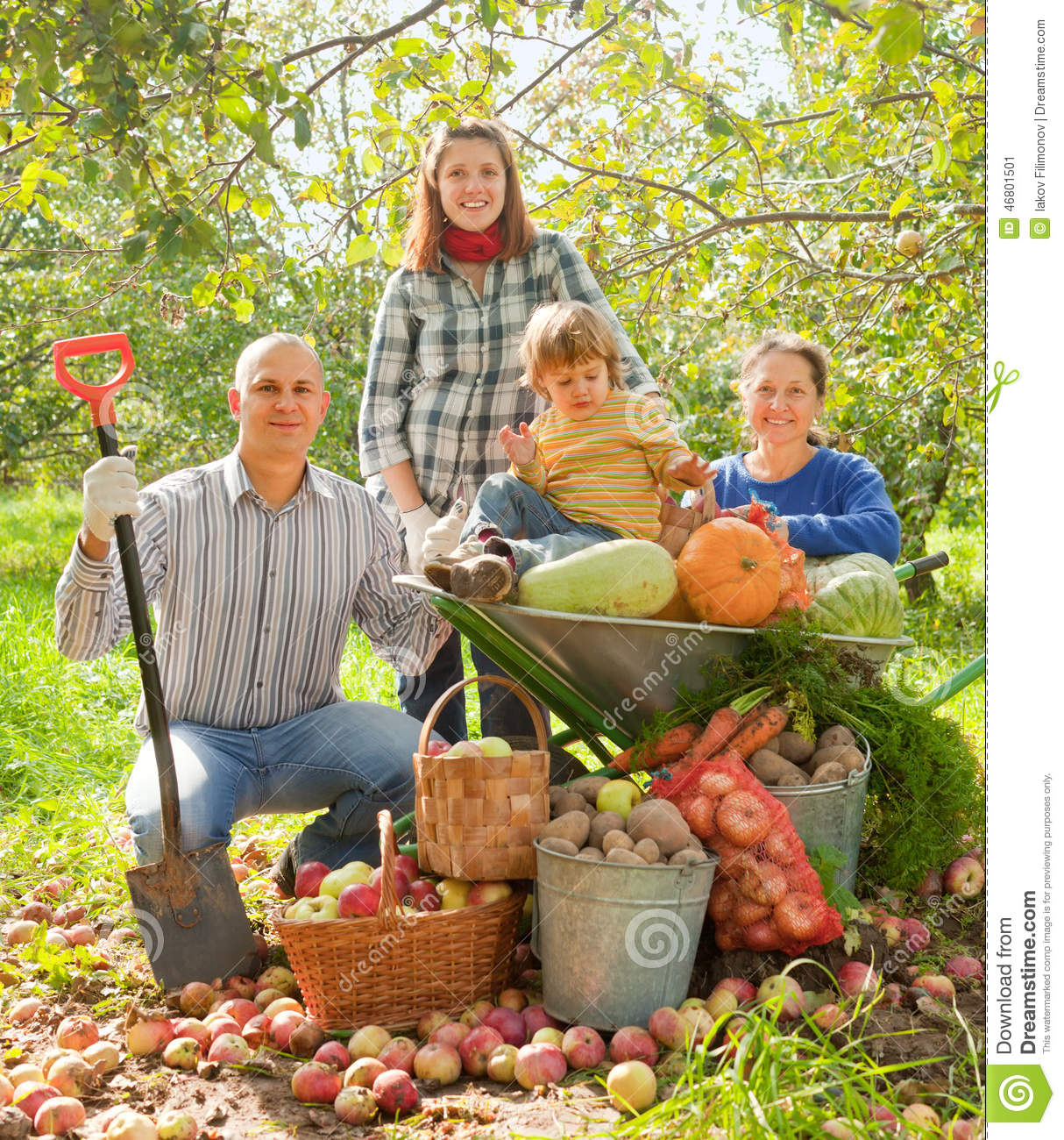 Happy Family In Vegetable Garden Stock Image