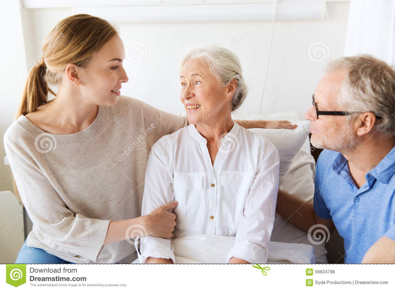 happy-family-visiting-senior-woman-hospi