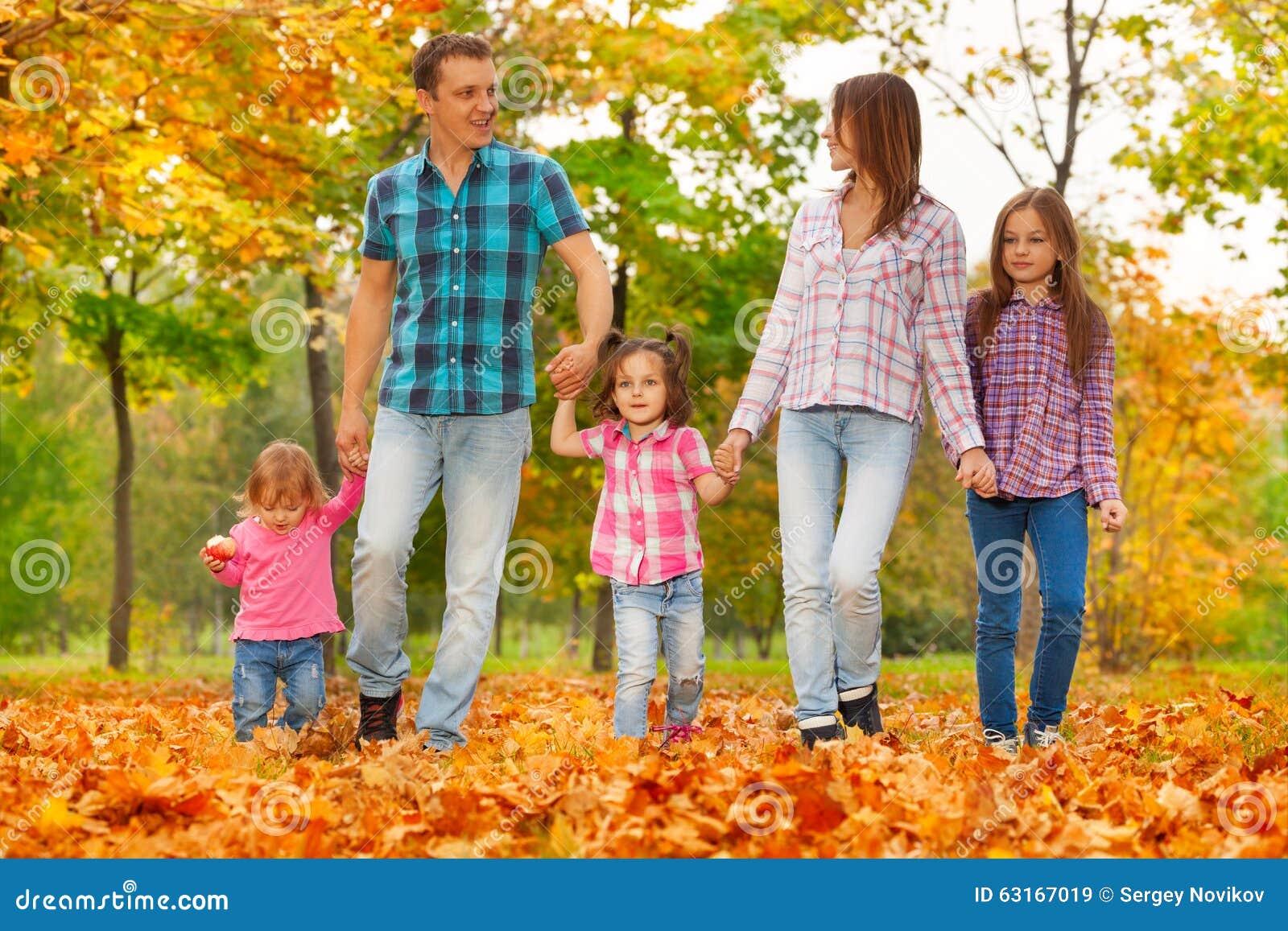 3 sisters photo shoot ideas - Happy Family Walk In Autumn October Park Stock