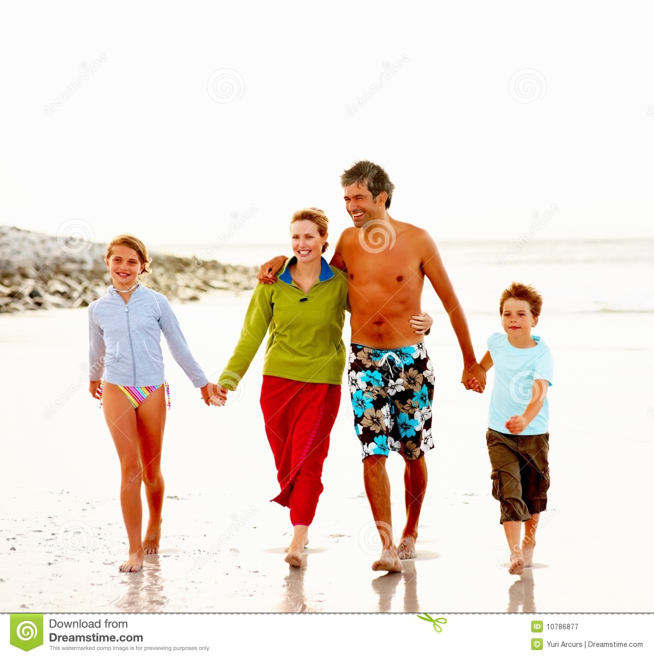 Family Enjoying Time Together On Beautiful Foggy Beach: Happy Family Walking On The Sea Shore Stock Image