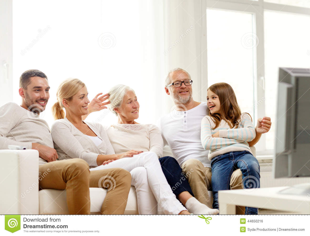 Happy family watching tv at home stock photo image of for People watching