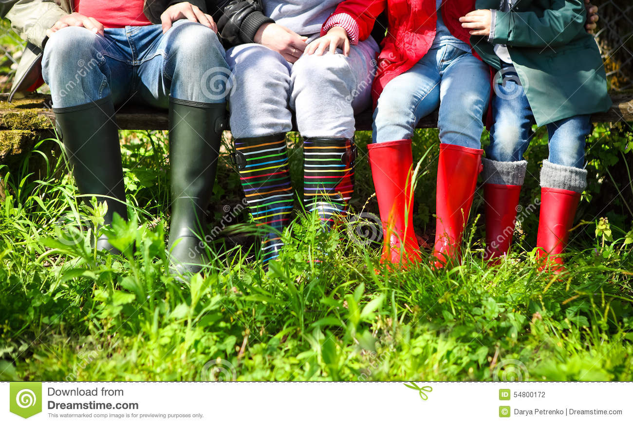 Happy Family Wearing Colorful Rain Boots Stock Photo