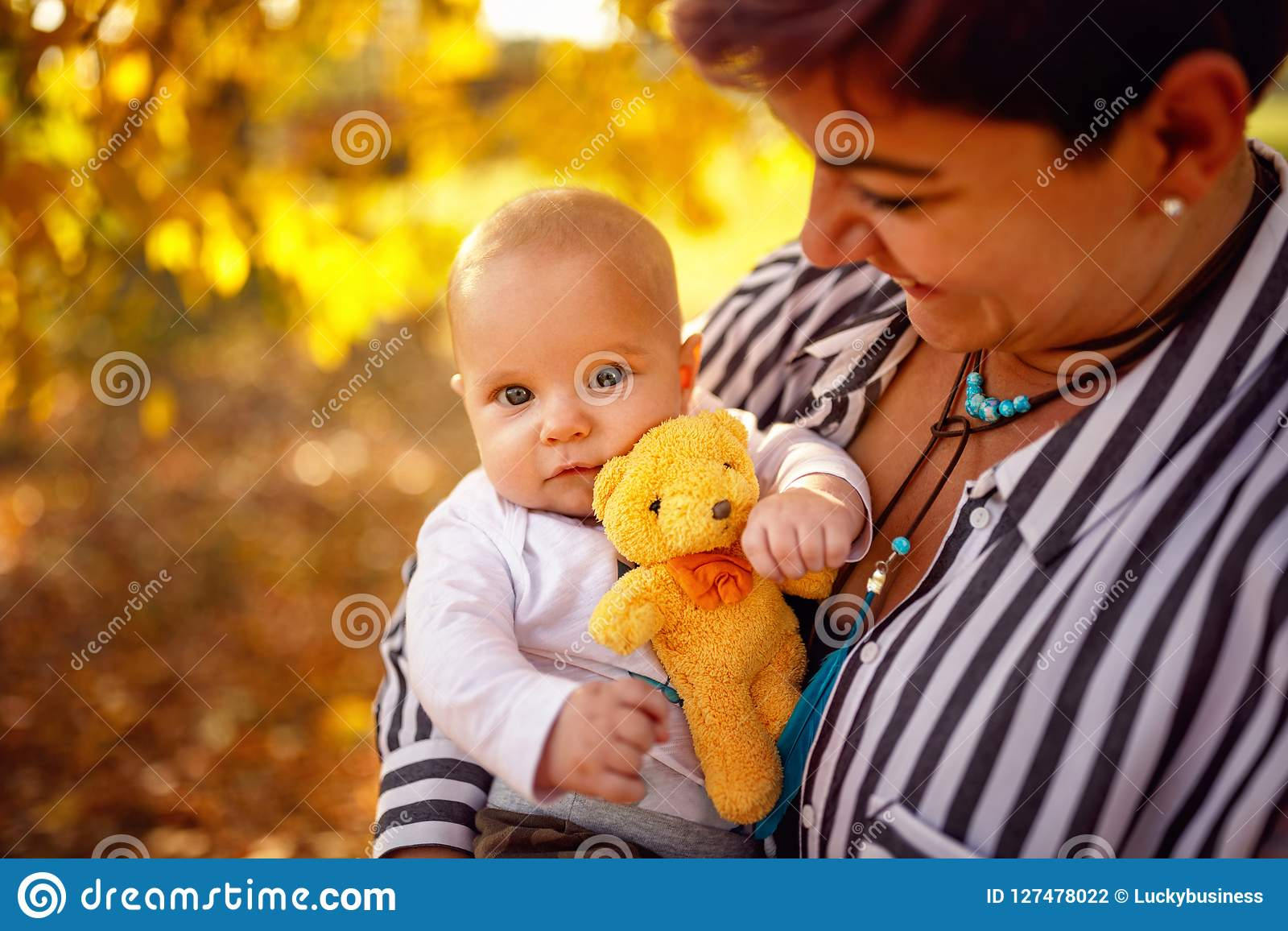 Happy family - Young mother and baby boy in autumn park