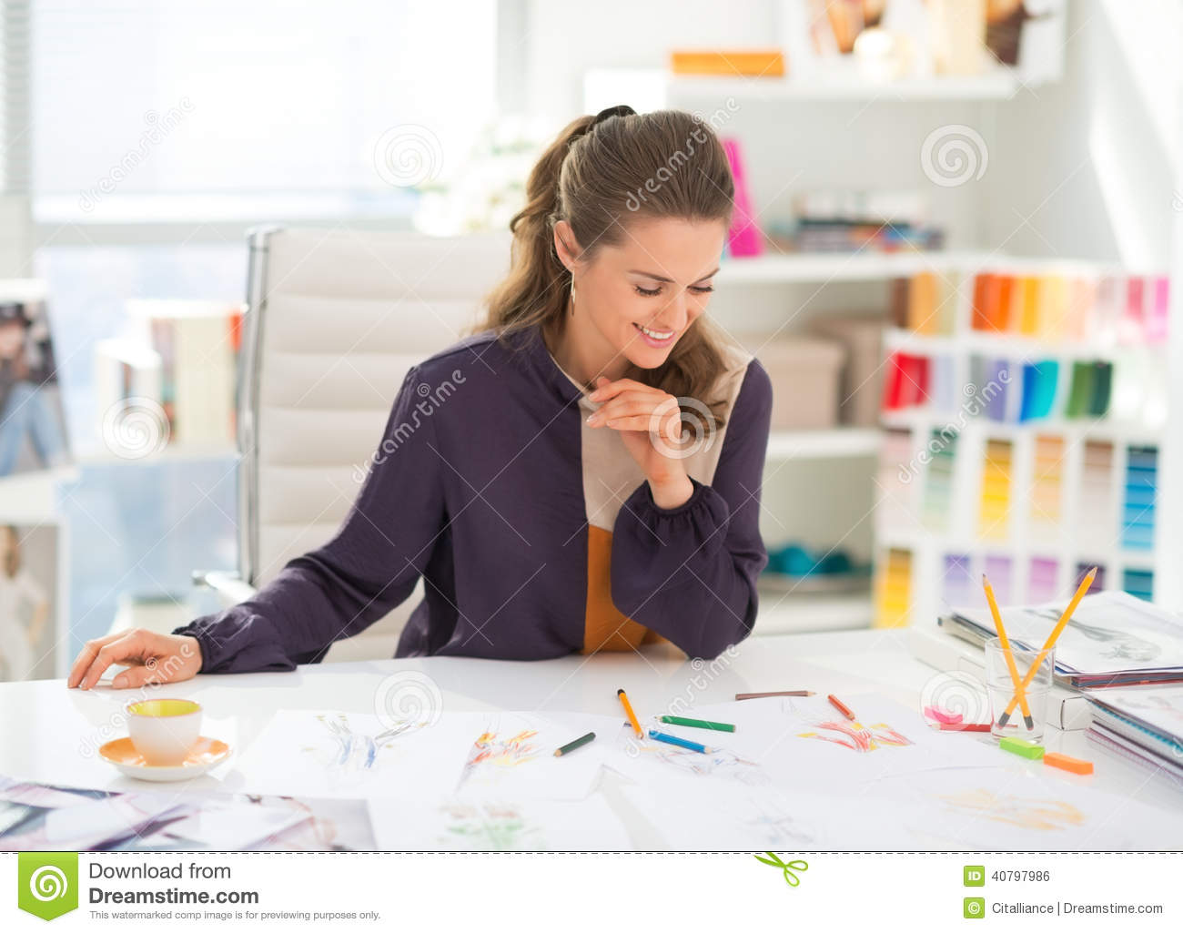Happy fashion designer working in office stock photo Office designer online