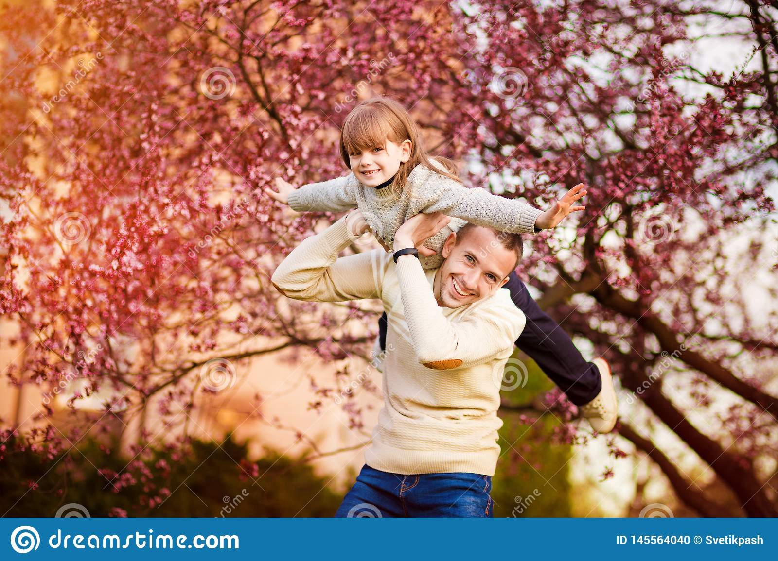 Happy father and child spending time outdoors. Family support