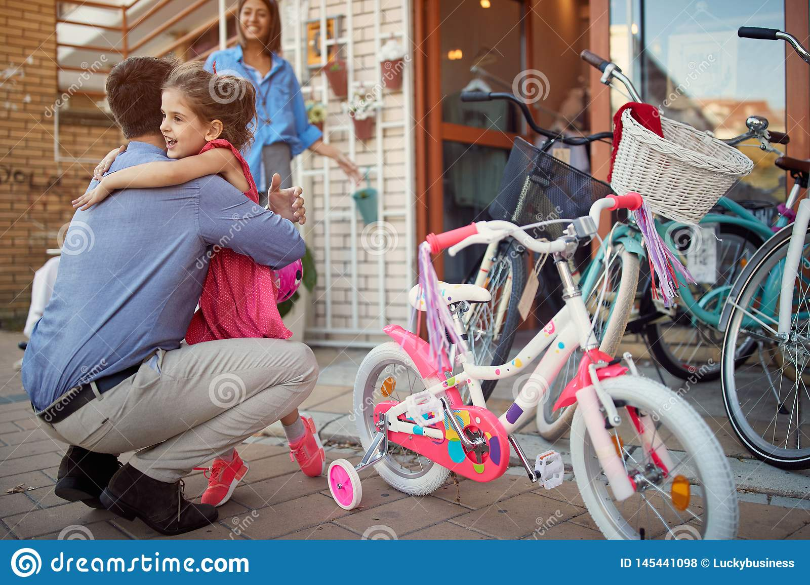 Father and daughter shopping new bicycle in bike shop
