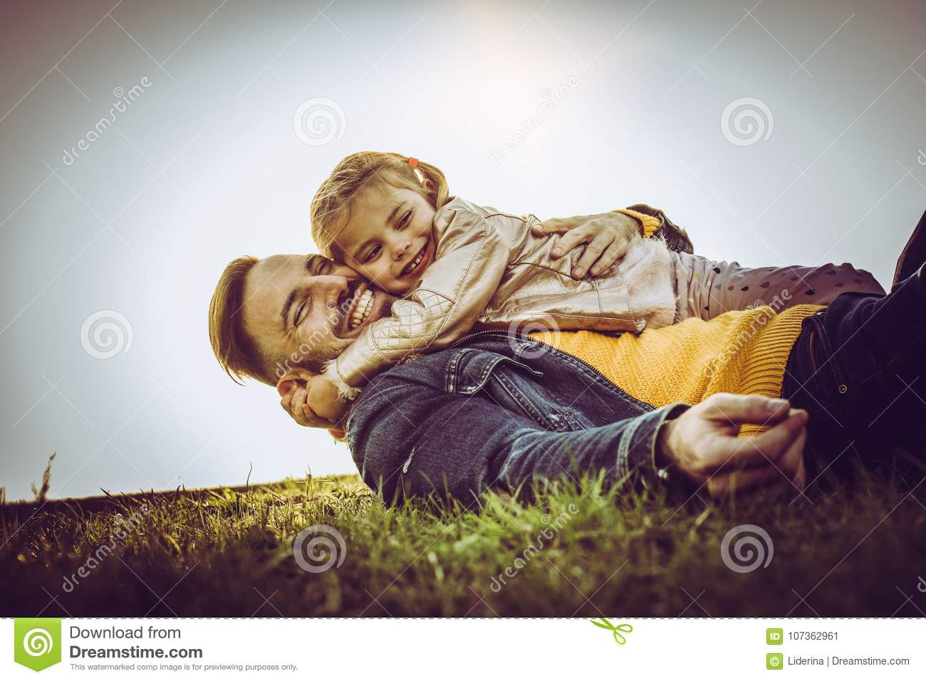 Happy father with his daughter outdoor.