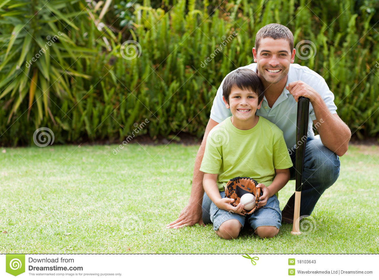 happy father and his son playing baseball stock photography