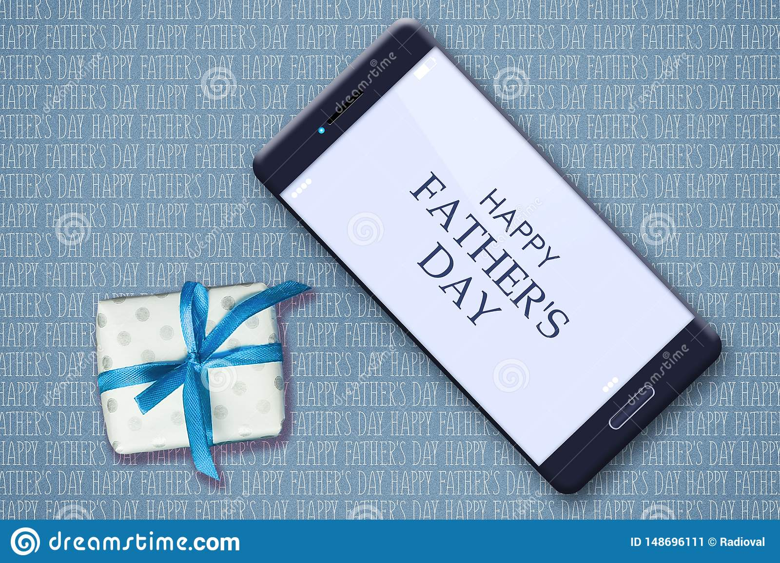 Happy father`s day background. Smartphone and gift on the background of many inscriptions Happy Father`s Day. Congratulatory