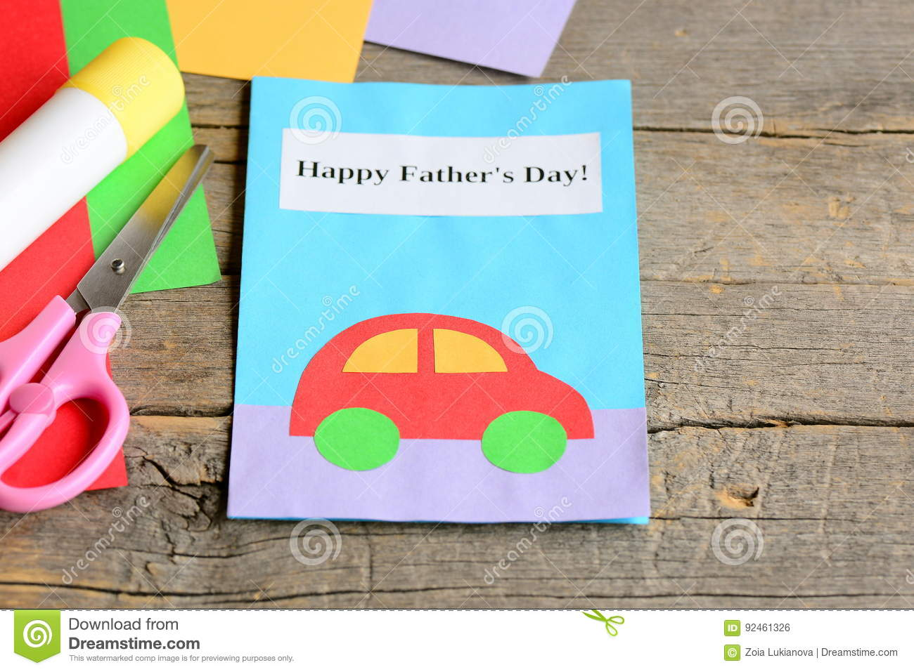 happy father`s day card. colored paper sheets, scissors, glue on