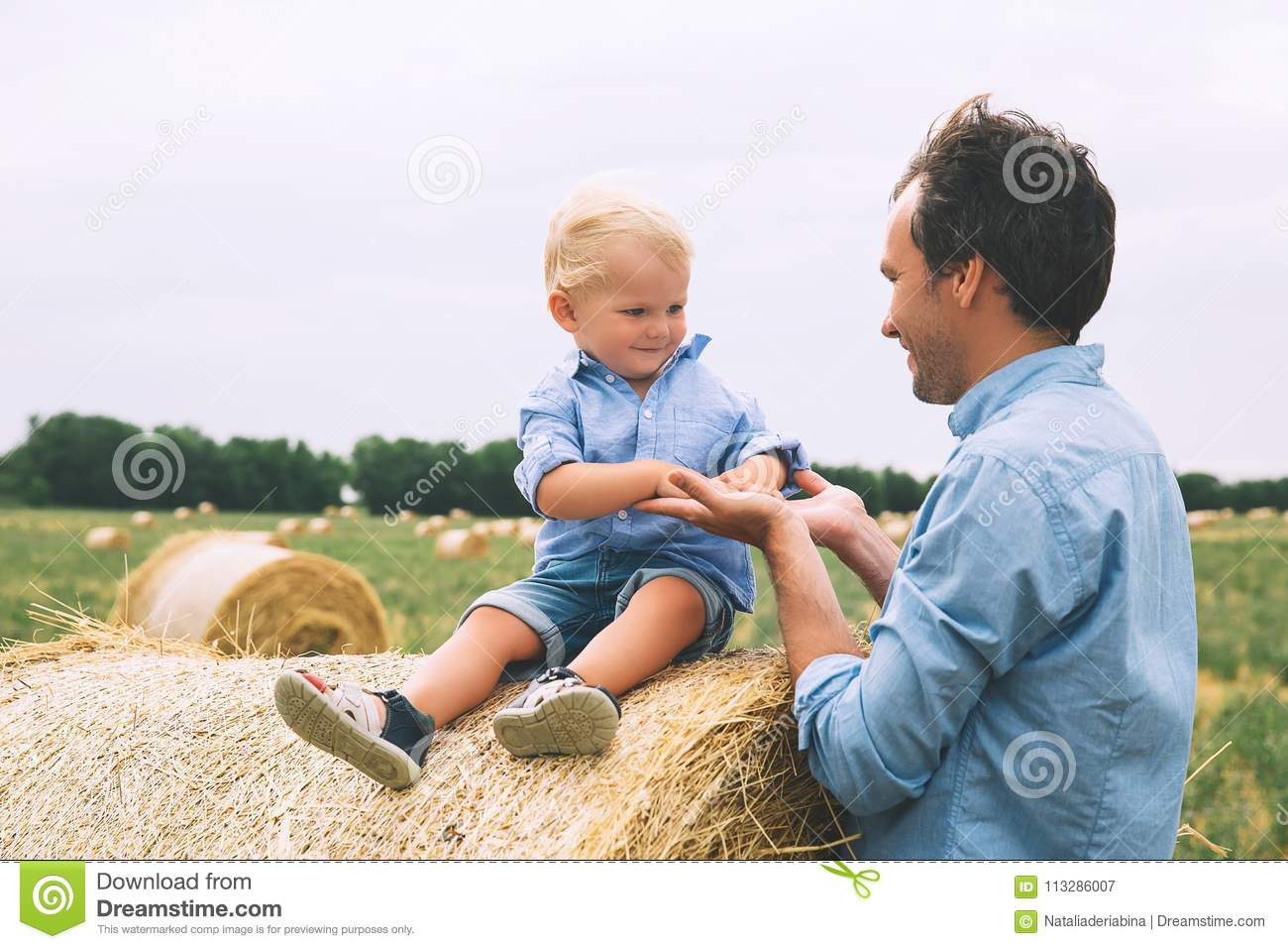 Happy father and son. Family outdoors together