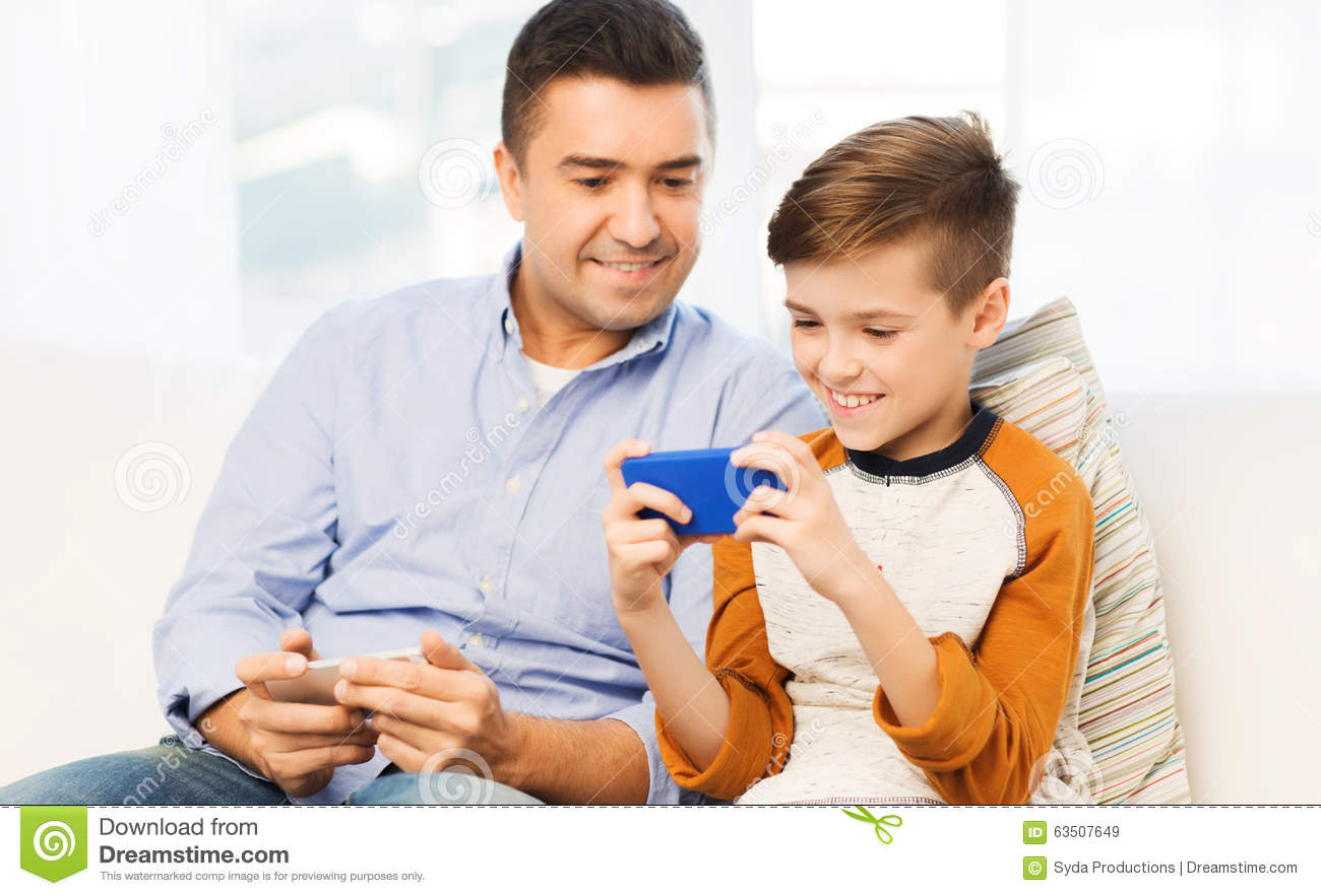 Happy Father And Son With Smartphone At Home Stock Image ...