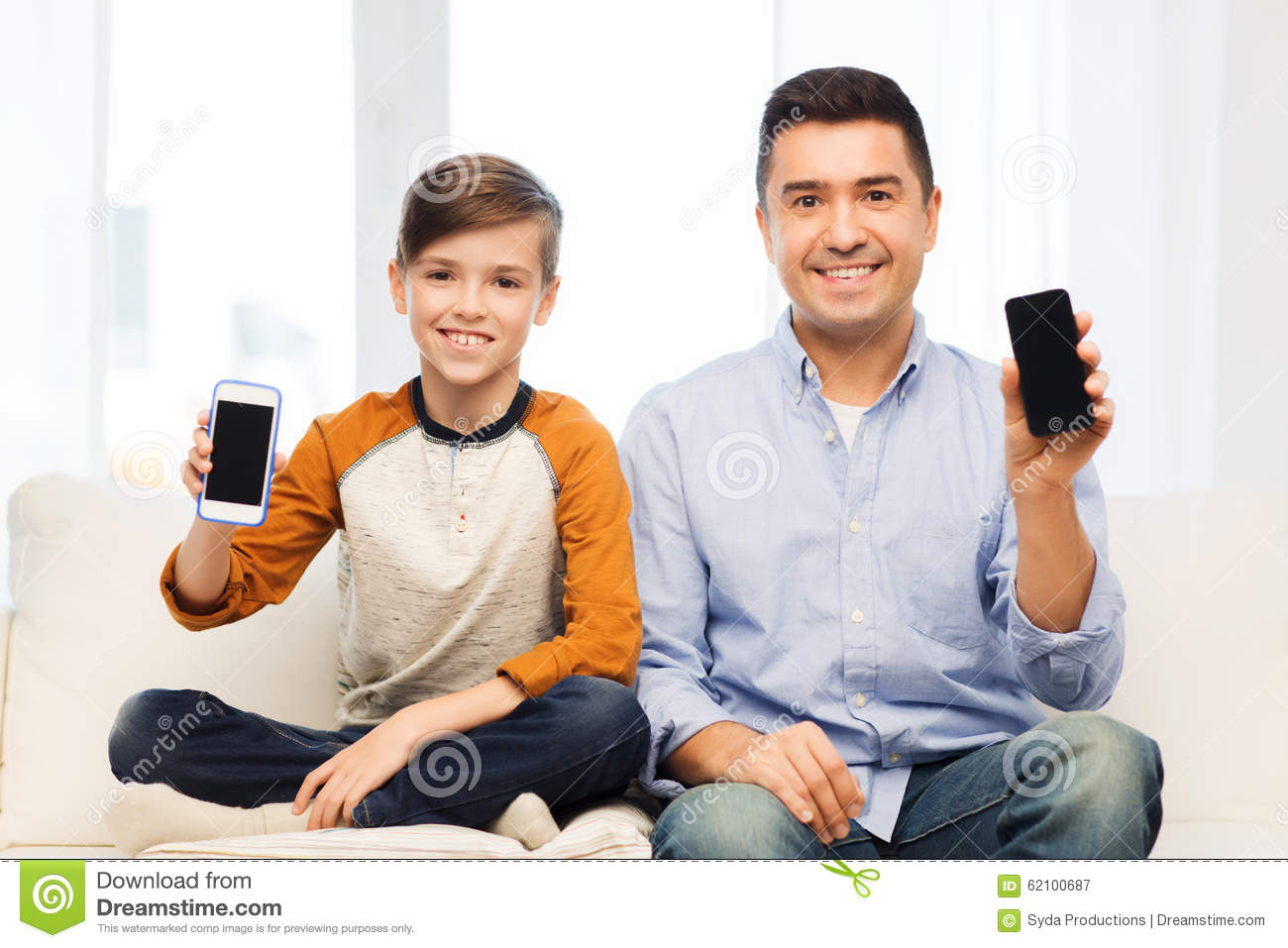 Happy Father And Son With Smartphones At Home Stock Photo ...