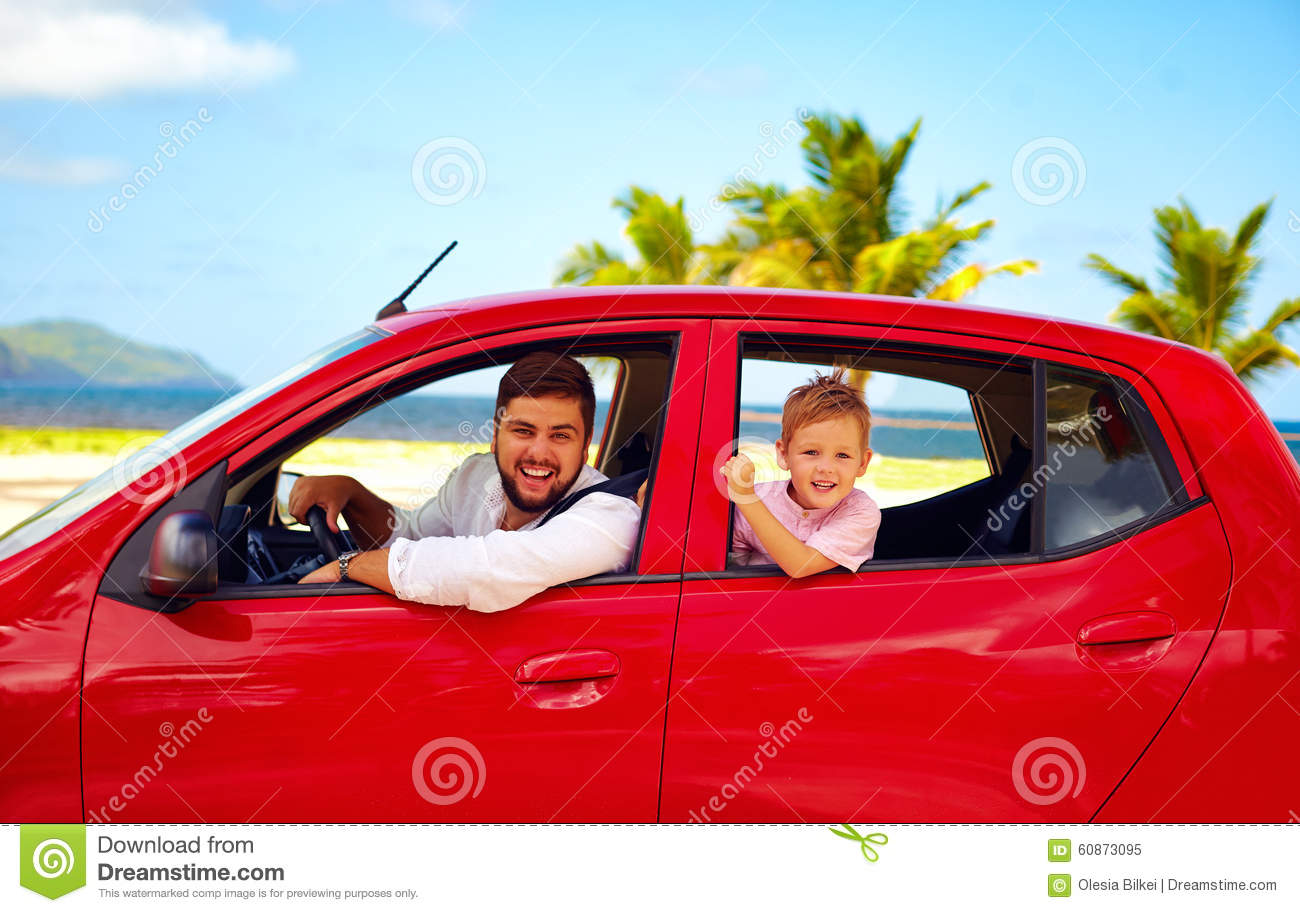 Happy father and son traveling in the car on summer vacation