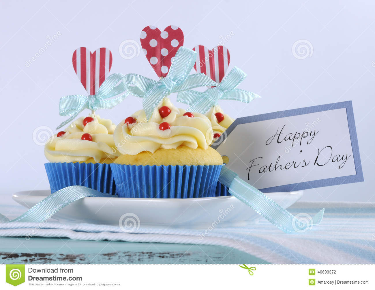 Happy Fathers Day bright and cheery red white and blue decorated cupcakes with heart toppers and gift tag
