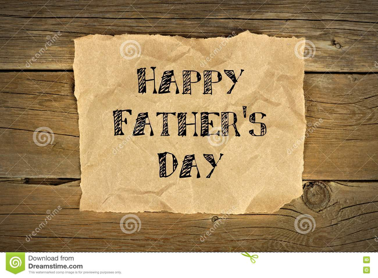 happy fathers day on brown paper on rustic wood