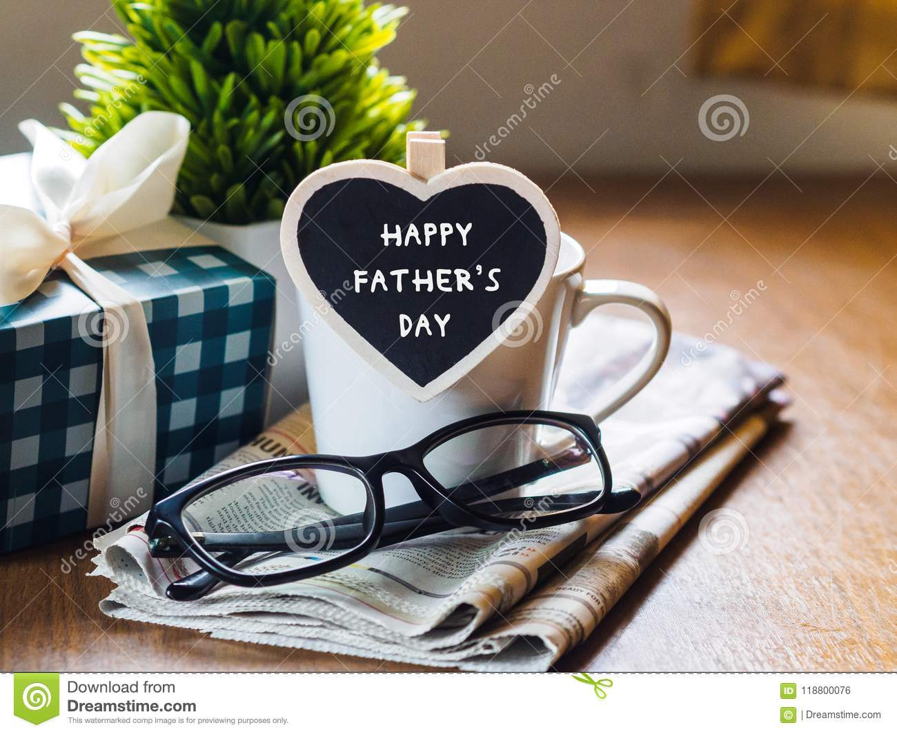 Happy fathers day concept. coffee cup with gift box, heart tag w