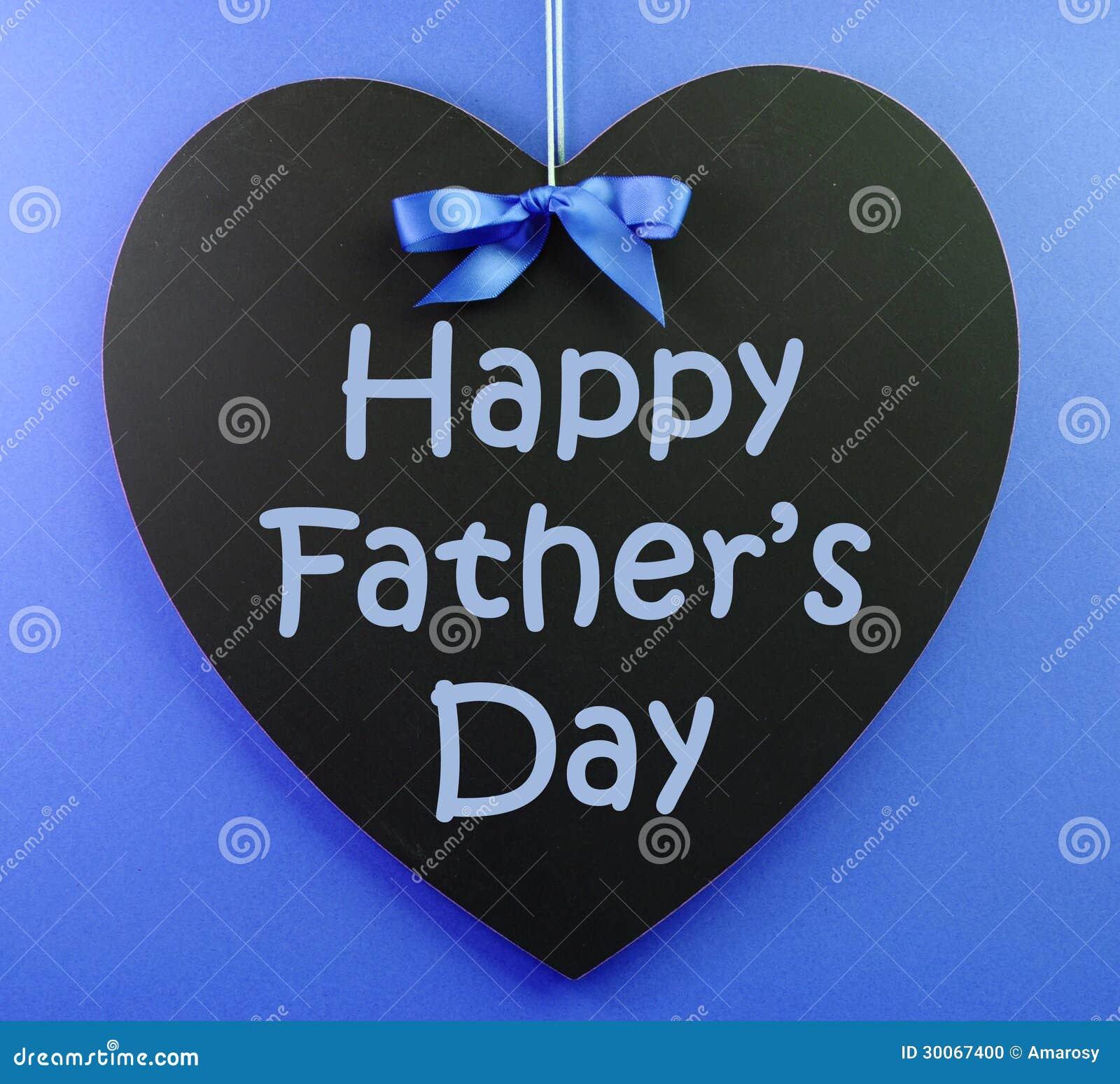 happy fathers day message written on a heart shape black blackboard