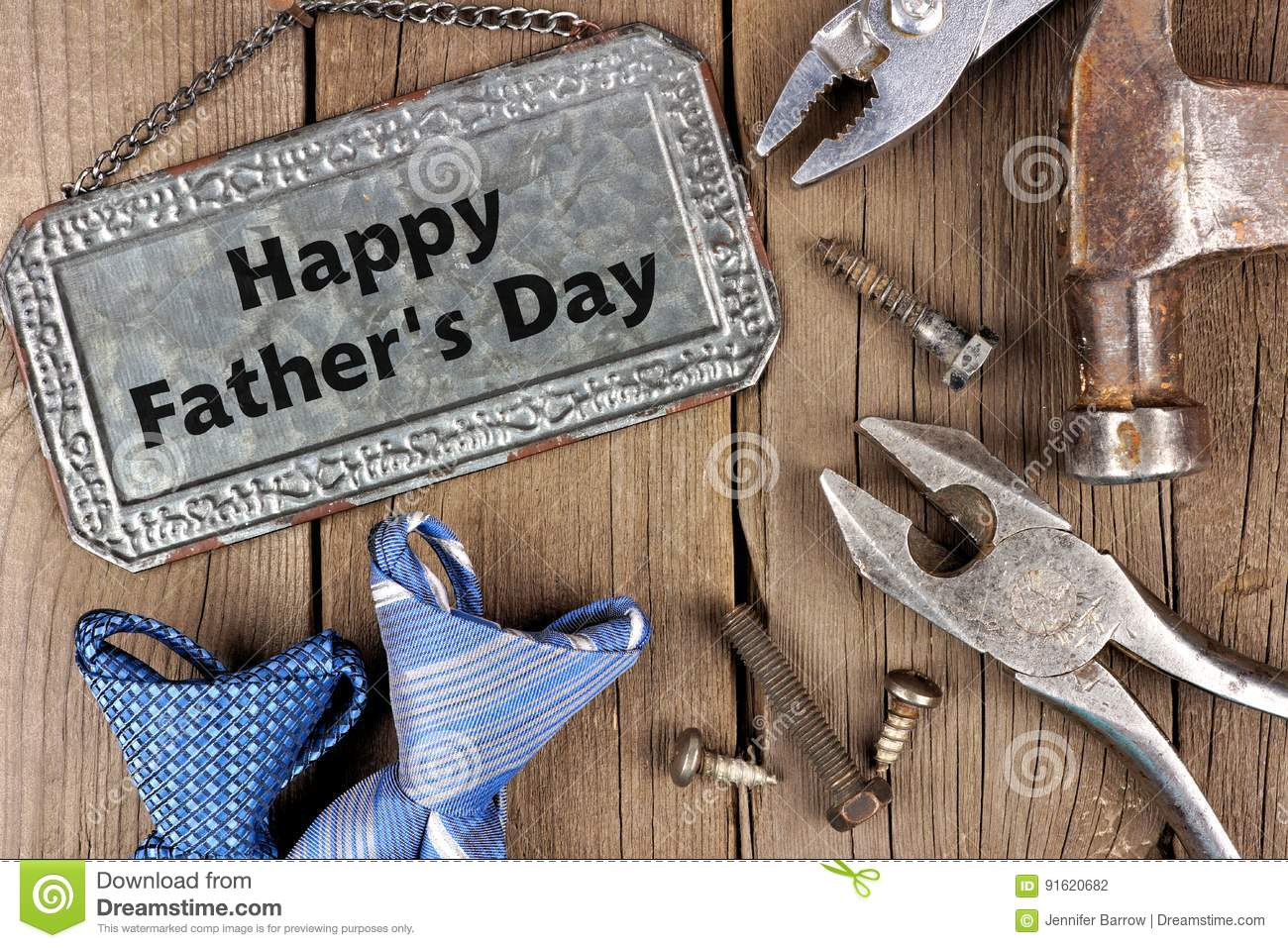 Happy Fathers Day metal sign with tools and ties on wood