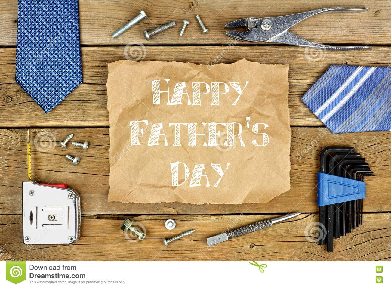 Happy Fathers Day on paper with frame on wood