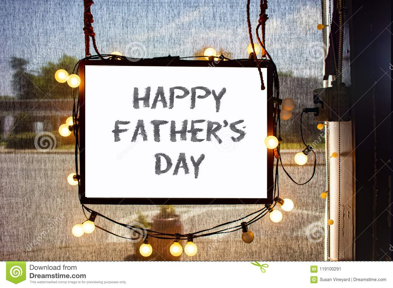 Happy Fathers Day Written On Hanging Sign Surrounded By