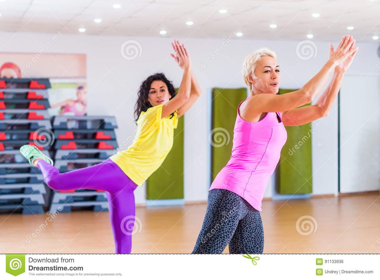 Happy female athletes doing aerobics exercises or zumba dance download happy female athletes doing aerobics exercises or zumba dance workout to lose weight during group ccuart Choice Image