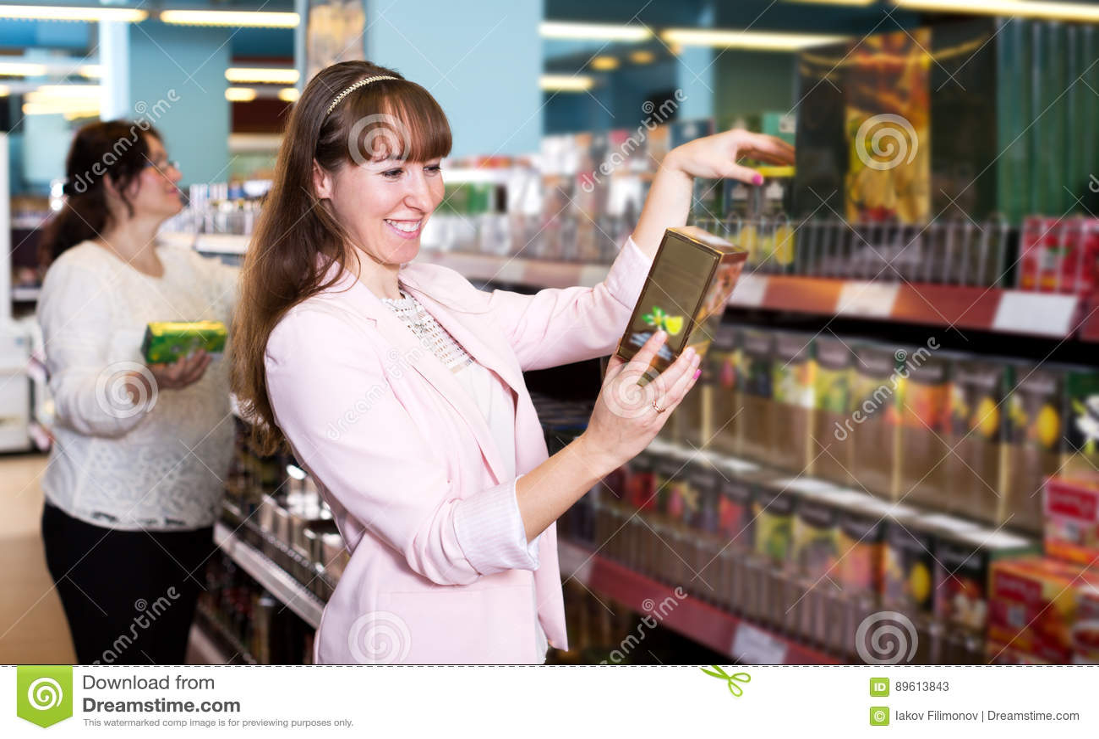 Happy female customers choosing black tea