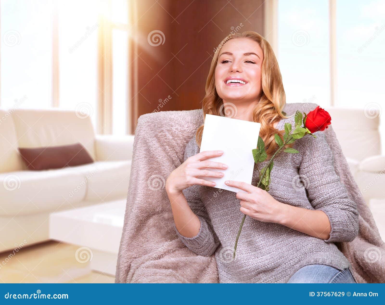 Happy female enjoying greeting card