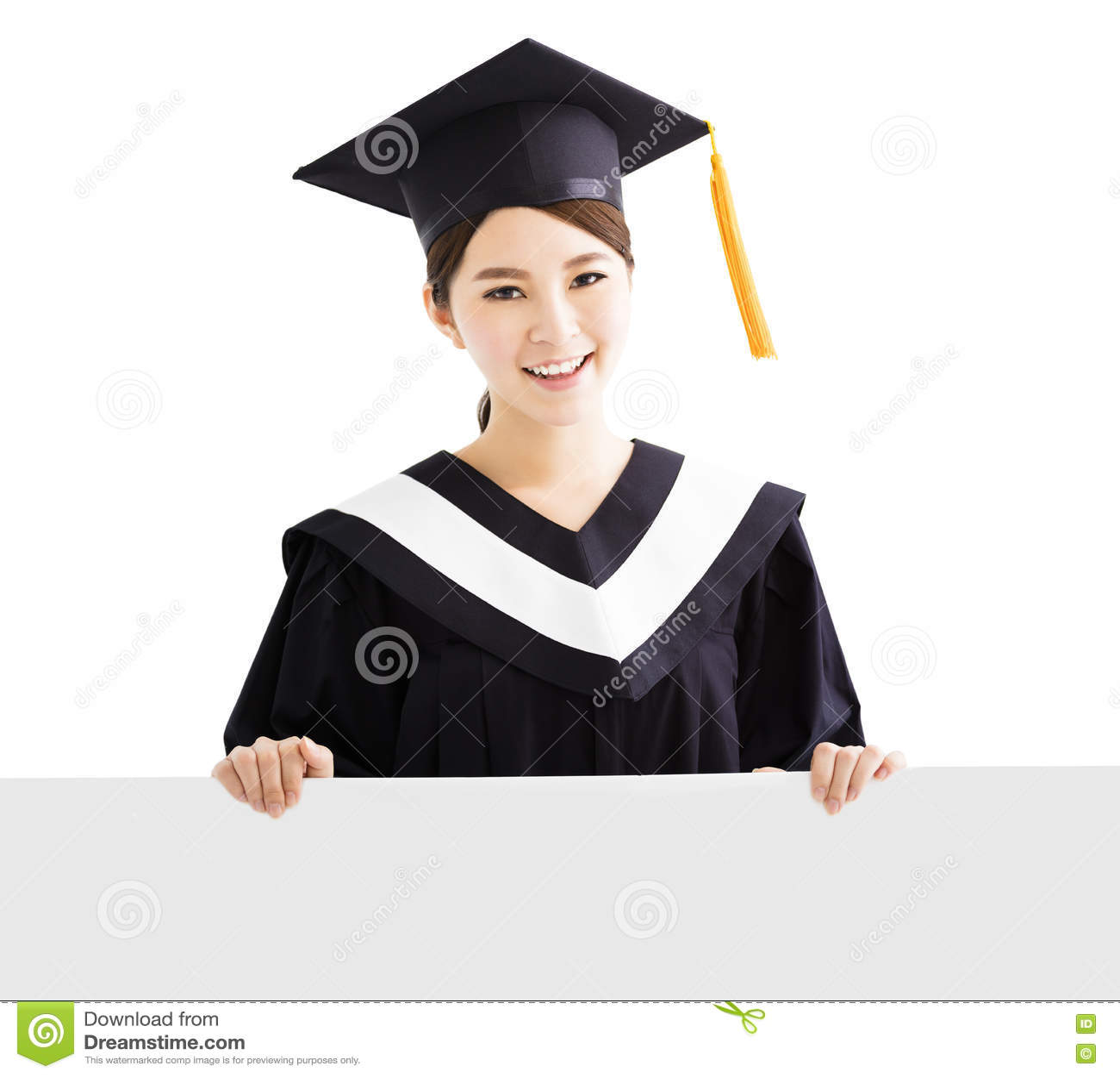 Woman In Graduation Gown Showing Blank Billboard Stock