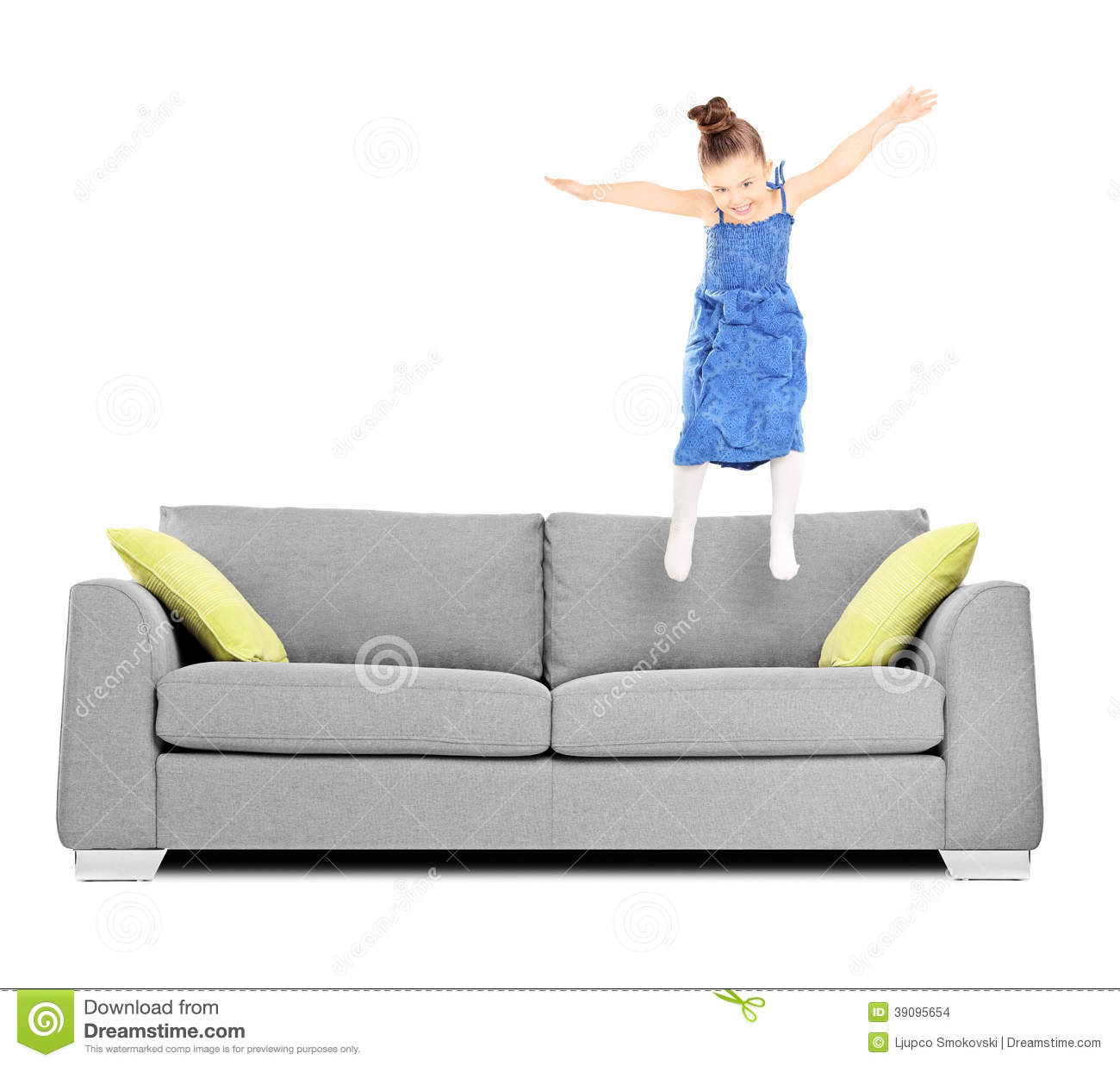 Happy Female Kid Jumping On Couch Stock Photo Image