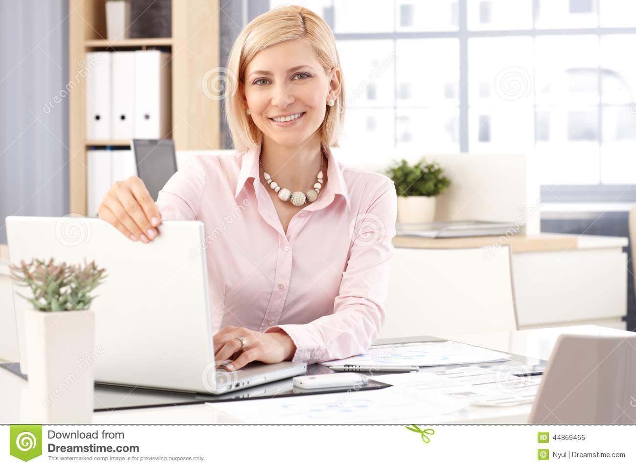 Happy female receptionist with laptop computer stock photo image happy female receptionist with laptop computer sciox Images