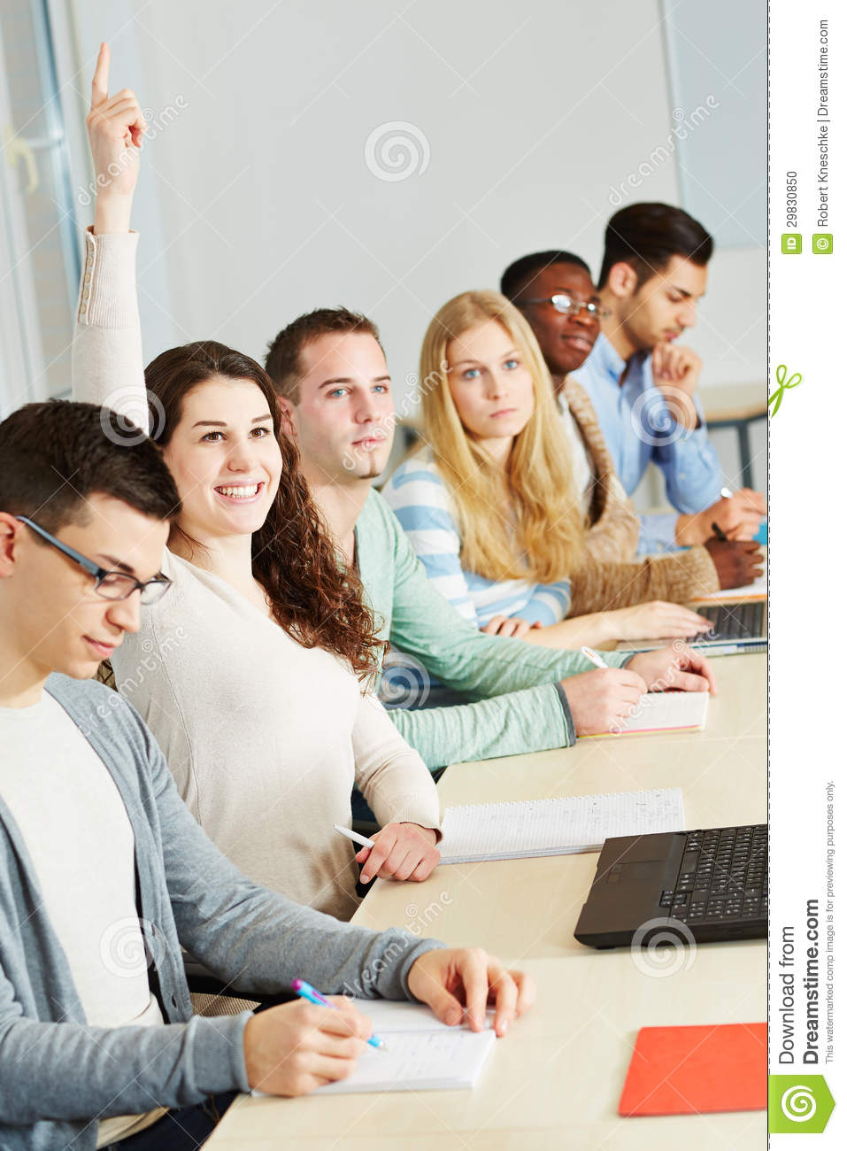 Student Raising Hand In University Stock Photo - Image: 29830850