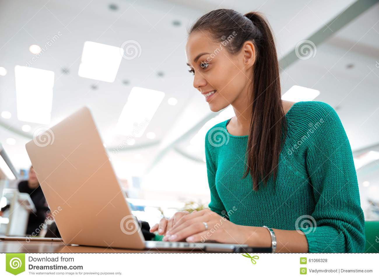 Download Happy Female Student Using Laptop In University Stock Photo - Image of hall, learner: 61066328