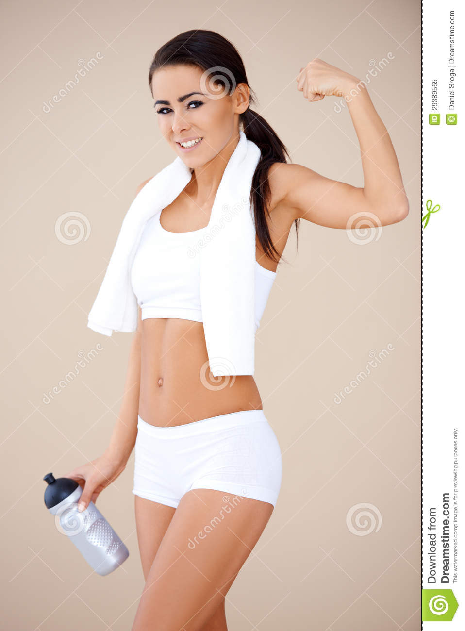 happy fitness girl showing her muscles
