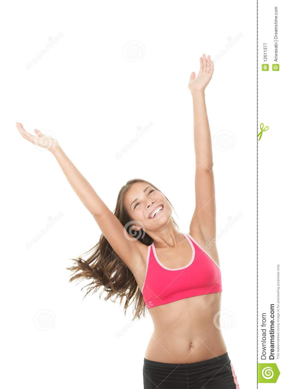Happy fitness woman with arms raised looking up