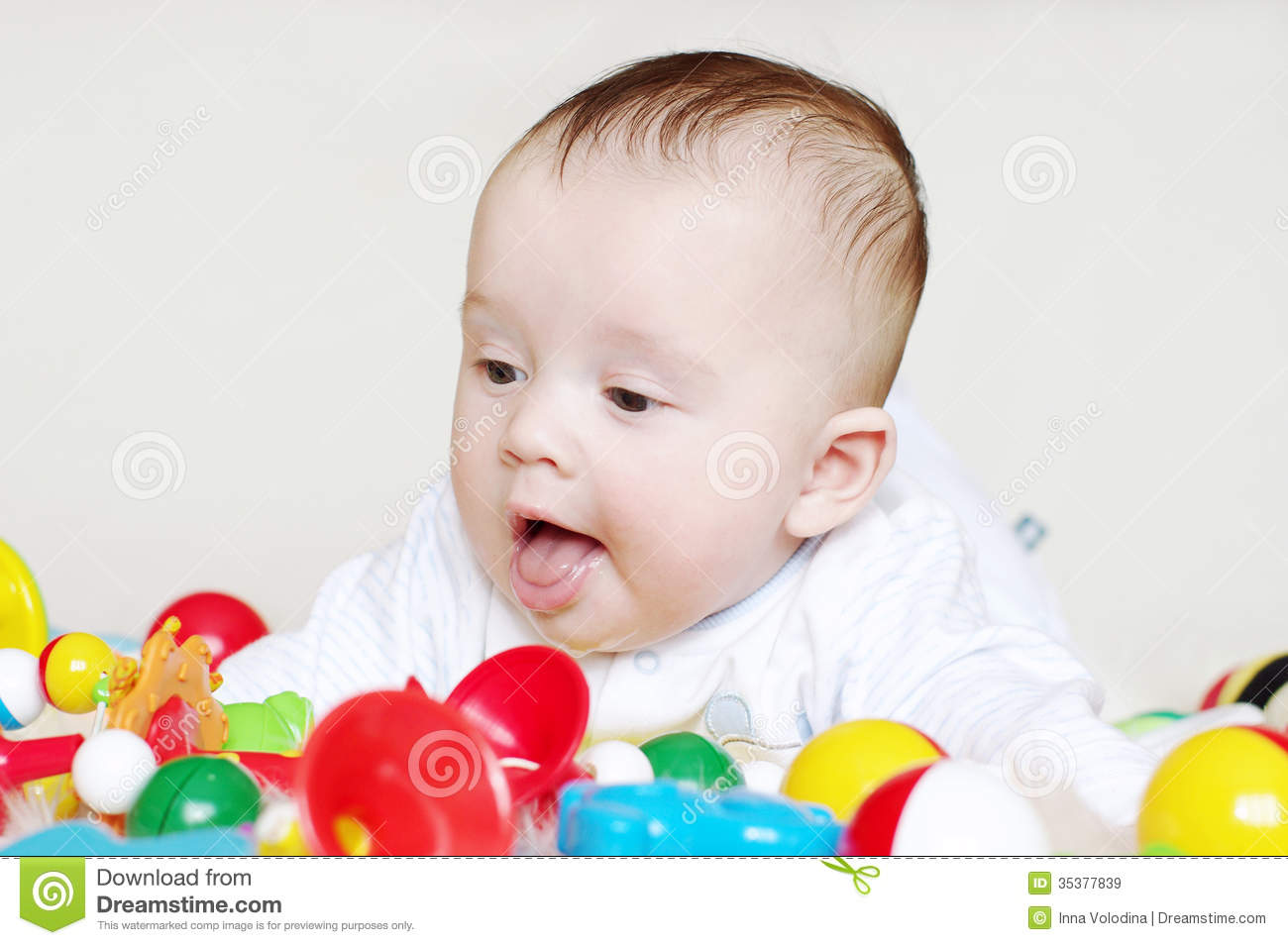 4 Month Baby Toys : Happy four months baby with toys royalty free stock images