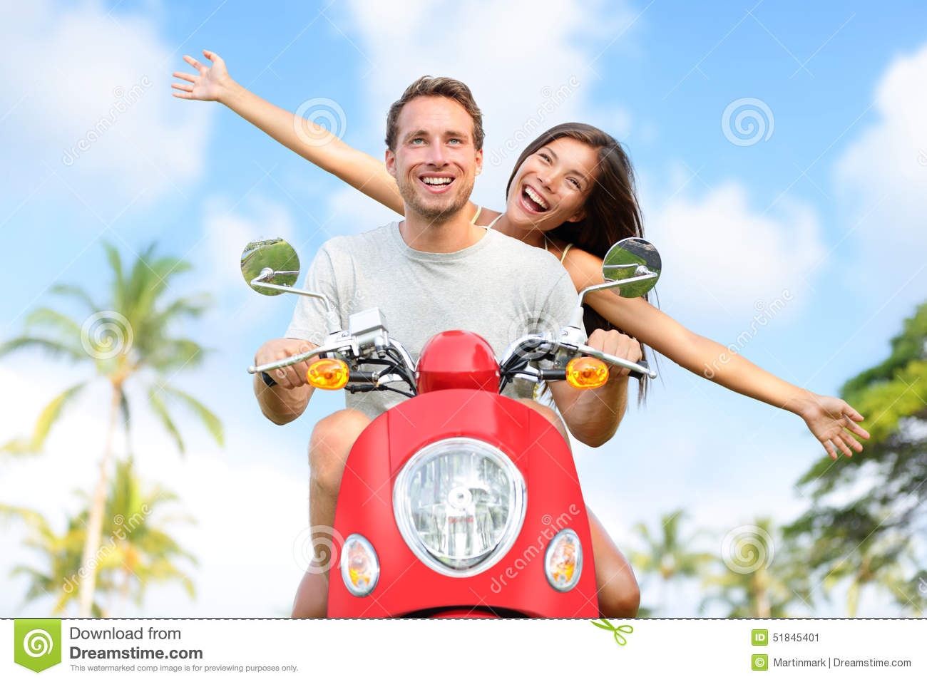Happy free freedom couple driving scooter
