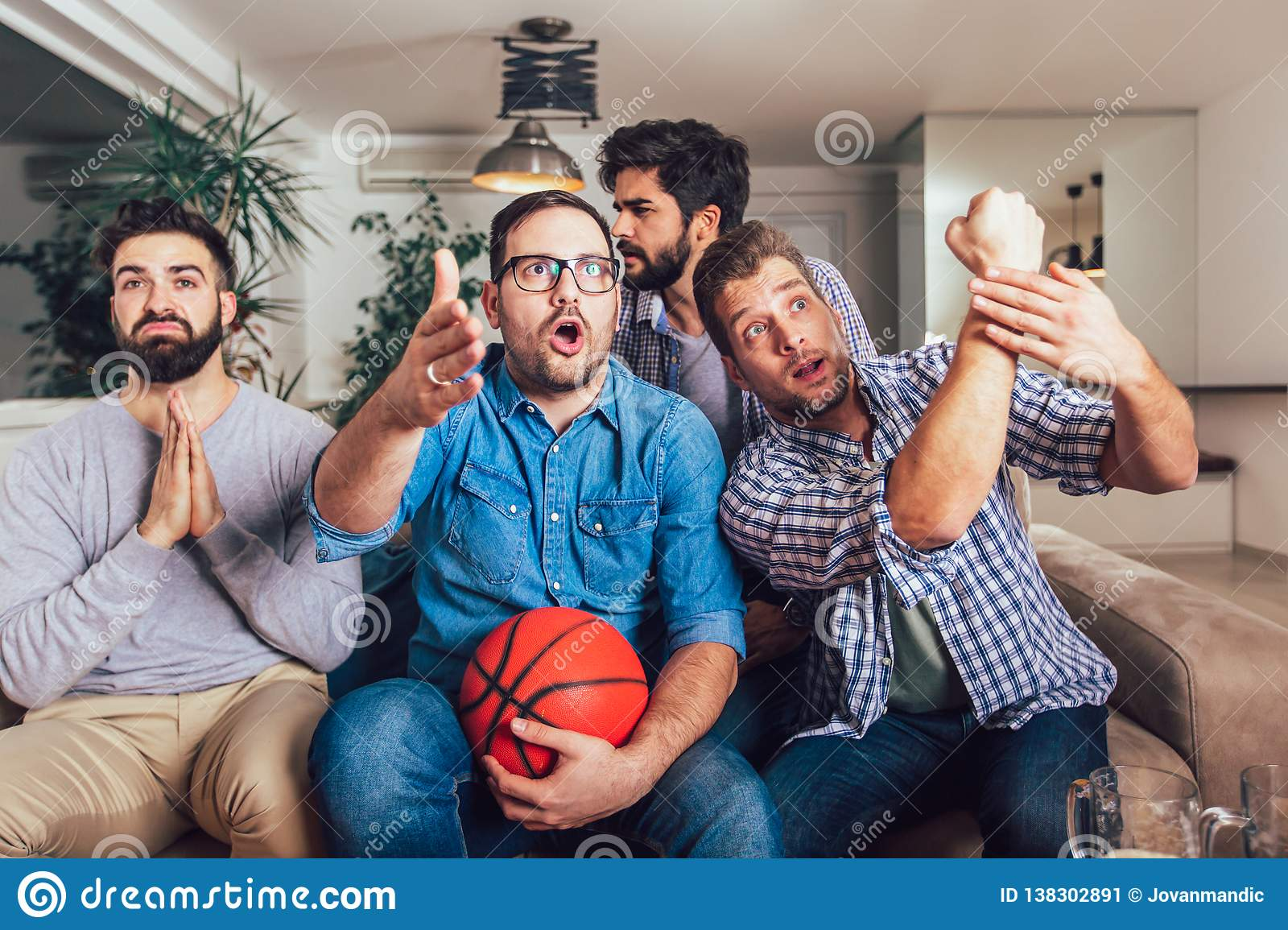 Happy Friends Or Basketball Fans Watching Basketball Game On Tv And Celebrating Victory At Home Stock Image Image Of Smiley Fans 138302891